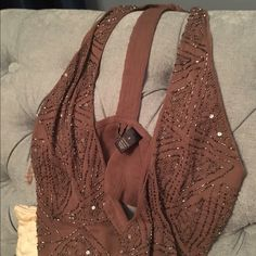Super cute brown sequined vest from Buckle This vest has sequins on the front and long narrow strip in back which allows the gorgeous lace insert of the cream blouse in my closet to show. Bigger discounts if you bundle. Bought it at Buckle BKE Jackets & Coats Vests