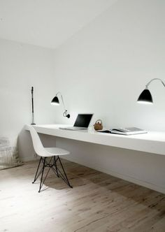 A pair of wall mounted Bestlite BL6 Wall Lamps serve as task lamps in a Copenhagen home office designed by Norm.Architects. Diffuse light fr...