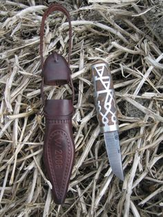 "Traditional ""hat puukko"", original model from Säkylä 1868, birch root, tin, leather."