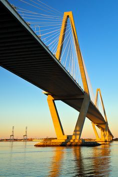 Bridge Wednesday - Port Ravenel Bridge, Mt. Pleasant, SC _ Graceful and imposing, the Ravenel Bridge stretches across the Cooper River, offering easy passage by foot or auto. Framed beneath the bridge's span are two container ship cranes, part of the Port of Charleston where thousands of tons of cargo pass each year.