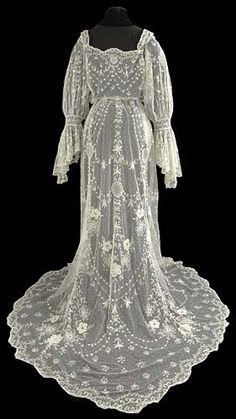 Ref:  The Lace Guild, UK, Museum.  Artefact of the Month picture for May 2010 - Tamboured wedding dress 1905–1910.