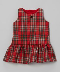 A festive plaid adds classic charm that makes this frock the life of the party. Buttons down the back and a darling rose appliqué create a polished look on every dressy little girl.