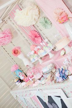 Shabby Chic Tea Party Decor via Kara's Party Ideas - Paper flowers and decorations are a cute idea :)