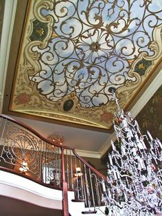 One of the prettiest, and best designed trompe l'oeil ceilings I have ever seen...