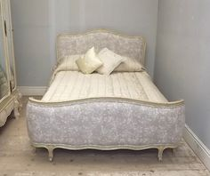 vintage french bed upholstered in Romo fabric