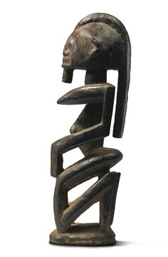 Dogon Kneeling Female Figure, Mali Height: 8 1/4 in (21 cm) Sotheby's New york In Pursuit of Beauty: The Myron Kunin Collection of African Art 11 November 2014 Sold 32,500 USD