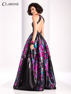 Floral Printed Clarisse Ballgown This floral ballgown with pockets and an  open back is perfect for all our edgy prom girls out there! b8a3cd53ab25