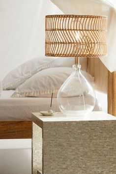 Infuse a classic silhouette with boho texture when you light up your space with this rattan-shade table lamp. Featuring a teardrop-shaped glass base, topped by a wavy strand rattan shade. Plugs in to power on with rotary socket switch. Home Interior, Interior Design, Natural Interior, Natural Home Decor, Decoration Entree, Table Lamps For Bedroom, Glass Table Lamps, Modern Table Lamps, Bed Side Lamps