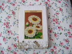 I would like to try making something like this on my own using old flower seed packets!