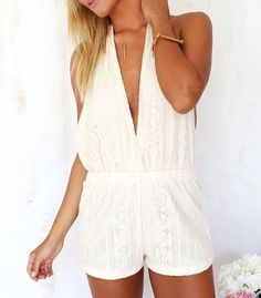 Lace playsuit with deep V neckline