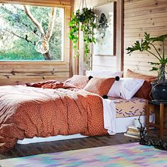 Dreamy wooden room with the orange and green of the plants is so fresh Kip and Co. SS13