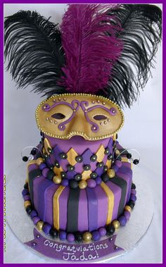 Mardi Gras Cake - would like this with a deeper/richer purple for the frosting and maybe silver instead of gold.
