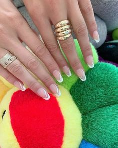 """Gigi and Bella Hadid Are Redefining the French Manicure The first photo is of Bella Hadid's cool French manicure with """"V"""" shaped wavy white tips and a white accent design on each nail. Cute Summer Nail Designs, Cute Summer Nails, White Tip Nails, Green Nails, Colored Tip Nails, French Nails, Bella Hadid, Gigi Hadid, Fall Nail Trends"""