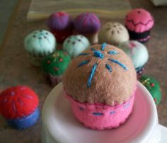 Mini Pin Cushions made with felt and a recycled bottle top.