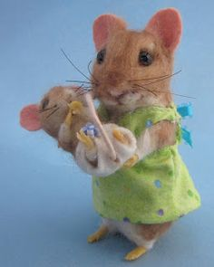 Here are my latest little ones.  Mindy, the mother mouse, stands at 5 inches tall and her tiny baby, Binkie, is only 1 ...