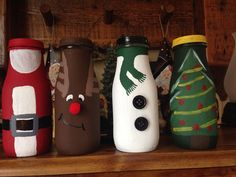 Used Starbucks frapp bottles and painted them as Santa, Rudolph, Snowman and Christmas tree. Starbucks Glass Bottle Crafts, Starbucks Frappuccino Bottles, Starbucks Crafts, Wine Bottle Crafts, Diy Bottle, Bottle Art, Easy Diy Crafts, Jar Crafts, Simple Crafts