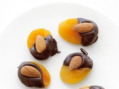 Dipped Apricots : For a fun, quick after-dinner sweet, dip dried apricots into dark chocolate and center an almond on top.