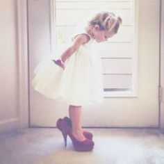 Omg.... I would love to have a picture of the flower girl in my shoes and take a picture like this and maybe on her wedding day give her my shoes O.o or not either way haha <3