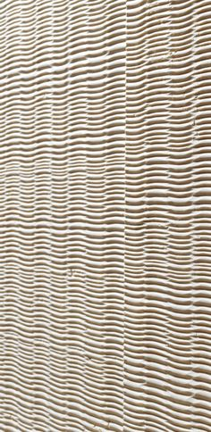 """Like wicker and its irregular fibres interwoven by the skilful hands of craftsmen, the """"fibra"""" designer stone panels show an aesthetic effect characterized by perfect but never rigid grooves and a whispered elegance. From the """"Cesello"""" collection. Marble Wall, Wall Tiles, Wall Paint Treatments, Printed Concrete, Stone Wall Panels, Coral Pillows, 3d Panels, Concrete Texture, Wall Finishes"""
