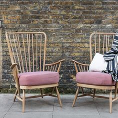 Ercol armchairs in front of brick wall from Bert & May