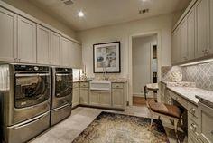 Traditional Laundry Room with High ceiling, flush light, Built-in bookshelf, Carpet, limestone tile floors