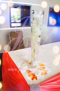 #Receiving table is very important for a #wedding reception mostly because its the first #impression when guests entering the #reception #banquet. Having #coral and #ivory drapery #decoration for the table and putting a #submerged #orchid using tall #vase is one classy way to express #wedding's #elegant and #romantic!