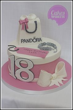 I Pandora themed cake with all handmade edible decorations including bracelet, bag and big bow. x