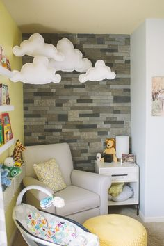 Reading nook: ikea shelves, DIY Clouds and Stone Wall in this Cozy Nursery Nook
