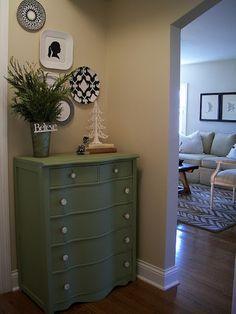 linen closet overflow dresser in the hallway