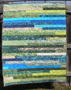 BLUE/GREEN JELLYROLL BATIK QUILT - Made by Kelly Millett - quilted by DLQ by DLQuilts, via Flickr - possible baby quilt idea