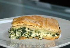 """TRY: """"Greek Spinach Pie or Spanakopita is a Greek style pie filled with spinach, ricotta cheese and feta cheese that will work as a side dish, appetizer or even a light lunch.""""  ---puff pastry instead of phyllo dough though---"""