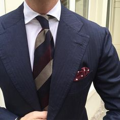 A closeup of The other day - Classic business essentials.  Mixed Stripe untipped Grenadine - Navy/Red tie l Classic polka Dot wool/silk pocket square - Burgundy l Classic solid slimline - White shirt… Shop our business essentials online at...