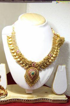 Heavy beaded gold necklace