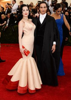 """Dita Von Teese (L) and designer Zac Posen attend the """"Charles James: Beyond Fashion"""" Costume Institute Gala at the Metropolitan Museum of Art on May 5, 2014 in New York City. (Photo by Dimitrios Kambouris/Getty Images)"""