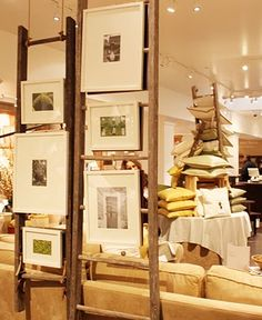 Cute idea with picture frames and old ladders.