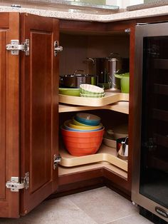 A lazy Susan definitely does not live up to its name. This hardworking feature organizes awkward corner cabinets to turn the cavernous space into a storage powerhouse.