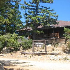 """West Point Inn, Mill Valley, CA - rustic Craftsman-style lodge (with wraparound deck) and surrounding cabins on the south slope of Mt. Tamalpais. Requires 2-mile hike along fire roads; views of San Francisco, Marin Headlands, East Bay. Mt. Tam's trails are at your feet, including the steep but gorgeous descent down to Stinson Beach."""" 