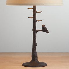 Woodlands Table Lamp Base | World Market. I LOVE these, thinking very seriously about buying two and one pink lampshade and another navy lampshade :) for our nightstands