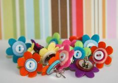 earrings... or thumbtacks. felt flowers with button centers