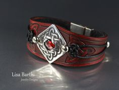 Hand made centerpiece in fine silver and the leather bracelet is cut, dyed and finished by hand to fit and lined with sheepskin for comfort. --Lisa Barth
