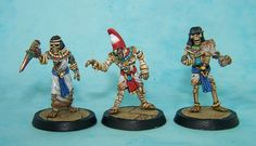 Dark Fable Miniatures  3 figure set includes a mummy pharaoh and two skeletal attendants, one of which has a separate arm.  20mm plastic slotta bases included.