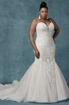 Inspiration Robe du Mariage : Maggie Sottero This style offers additional coverage to our Alistaire gown. This glamorous fit-and-flare wedding gown features a bodice of lace motifs, drifting into a tulle skirt trimmed in horsehair. Designer Wedding Dresses, Bridal Dresses, Curvy Wedding Dresses, Plus Size Wedding Gowns, Maggie Sottero Wedding Dresses, Fit And Flare Wedding Dress, Bridal Style, Afro, Marie