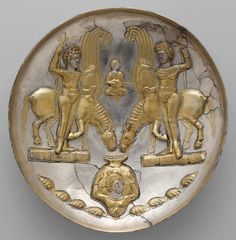 Plate with youths and winged horses  Period:  Sasanian  Date:  ca. 5th–6th century A.D.  Geography:  Iran  Culture:  Sasanian  Medium:  Silver, mercury gilding  Dimensions:  H. 5.2 x Diam. 21 cm, 572g (2 1/16 x 8 1/4 in.)
