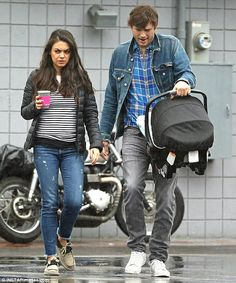 Unprepared: Mila Kunis and Ashton Kutcher nixed the rain gear as they stepped out for breakfast during the downpour in Los Angeles on Friday