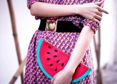 Charlotte Olympia Watermelon clutch paired with a belted printed dress