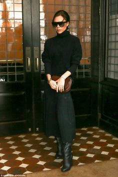 Leggy lady! She teamed her chunky jumper with a pleated mid skirt that flared over her enviably long legs and exposed a pair of leather wedge heeled boots