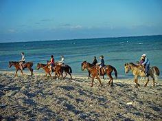 Horse back riding on the beach in Santa Lucia, Cuba