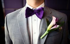 For the groomsmen.. Purple bow tie & grey suit! Perfect. Small purple boutonniere and pocket square to complete the look