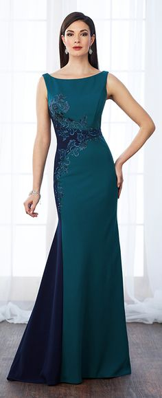Sleeveless crepe and lace fit and flare gown with bateau neckline, V-back, lace trims color block through natural waist and down right side of gown, sweep train. Matching shawl included.