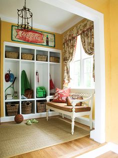 Teeming with sports gear, this mudroom's goal is to simplify life for an active family. A bench under the window gives youngsters a place to plant themselves while suiting up for activities. In addition to the open lockers, wicker baskets hold equipment and can be tucked into locker niches.